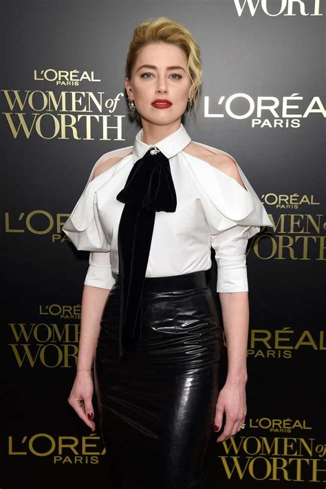 Amber Heard Attends the 14th Annual L'Oreal Paris Women of