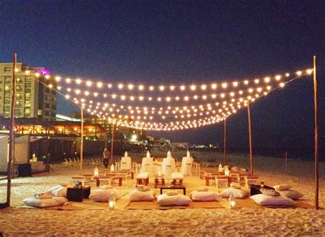 romantic and intimate beach party set up   Beach bonfire